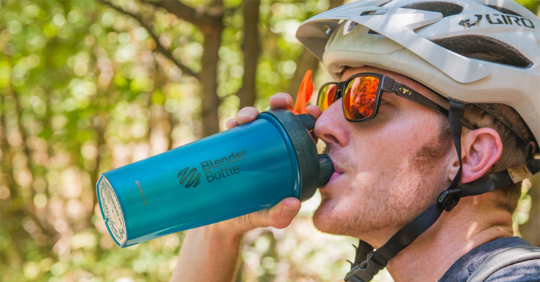 Man Drinking From a BlenderBottle Brand Protein Shaker Bottle
